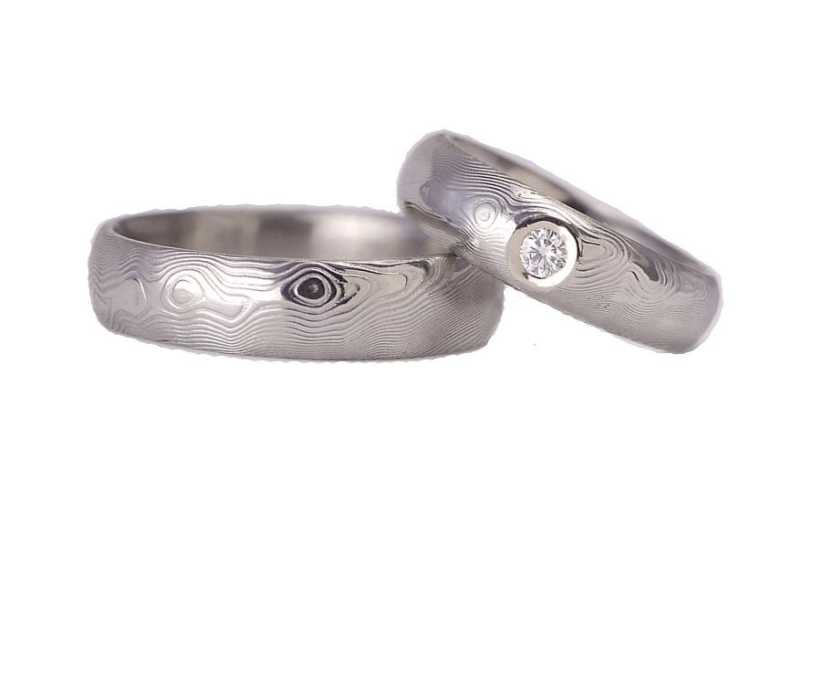 Snubní prstýnky Damasteel Moissanite v bílém zlatě - pár
